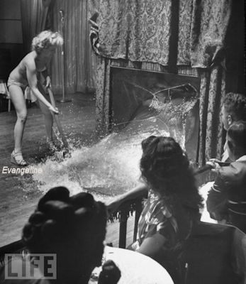 Evangeline, the Oyster Girl at Casino -Photo showing Divena's 300 gallon Glass Tank being shattered by Evangeline during Divena's act.