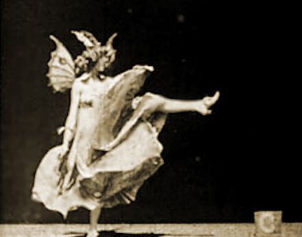 Annabella Moore [7/6/1878 - 12/1/1961] Vintage female dancer who danced in a few Edison movie shorts.  Pictured here doing her 'Butterfly dance'.