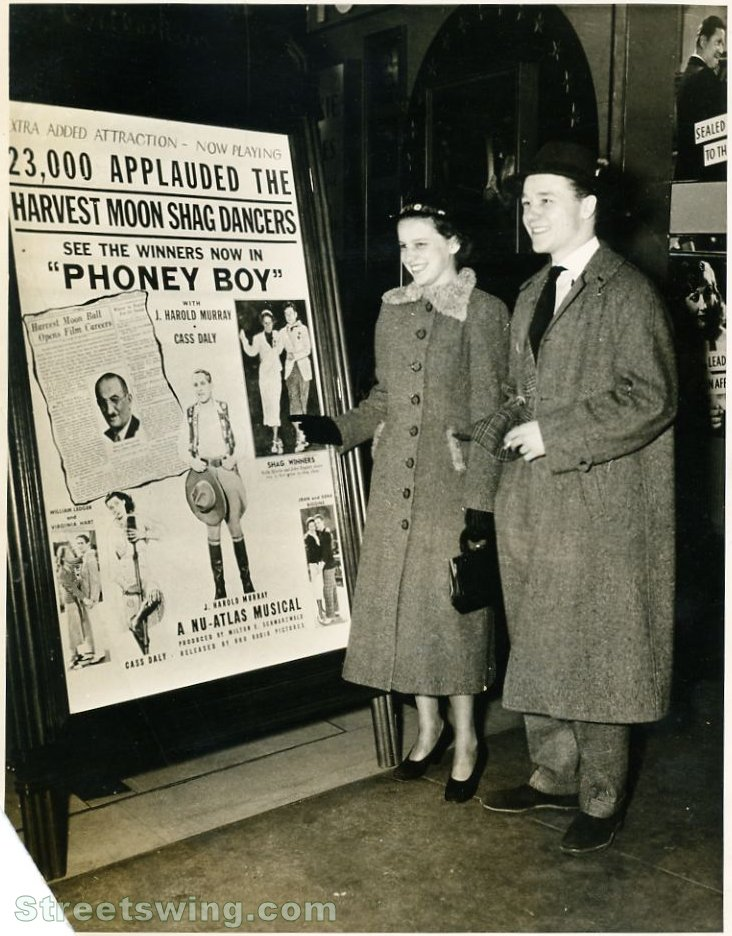 Ruth Scheim and John Englert in front of Phoney Boy Sign. 1938