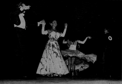 Four Ballroom dancers (2 couples) dancing at the Harvest Moon Ball dance championships. circa: 1940's.