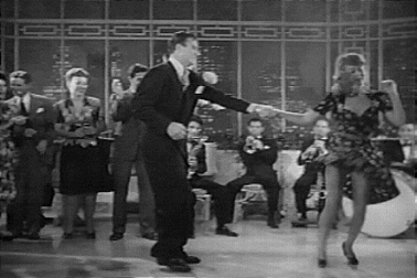 John Wayne doing the Jitterbug in the Movie Fighting Seabees with Adele Mara