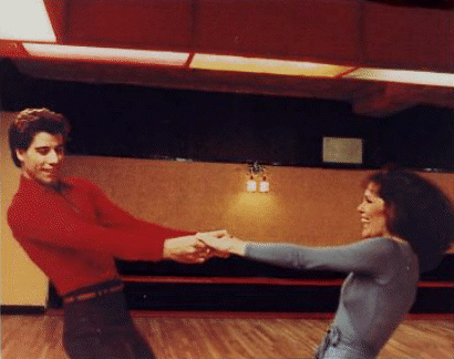 Travolta and Gaynor dancing in SNF