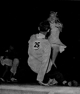 Jitterbug dancers dancing at the Harvest Moon Ball dance championships. circa: 1940's.